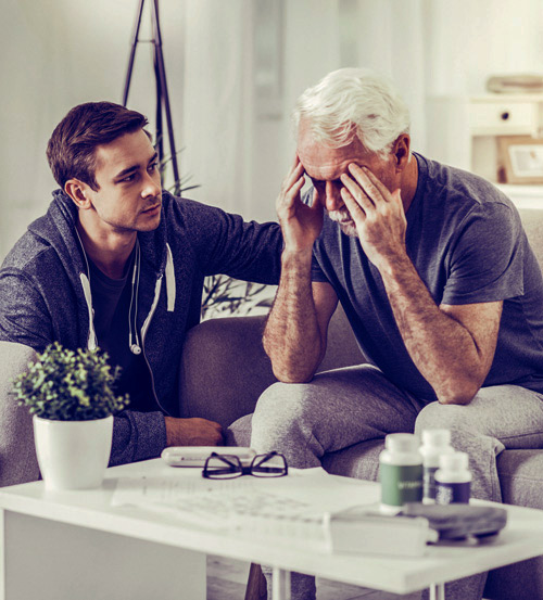 grown son with worried senior father