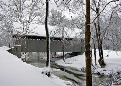 covered bridge during winter
