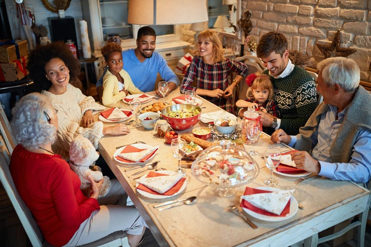 large family at dinner table for holiday gathering - talking - your family